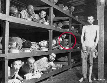 Elie Wiesel looks out from the far right of the middle bunk.
