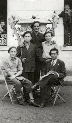 Elie Wiesel is center-top with a group of friends all wearing similar berets, at Ambloy, France.