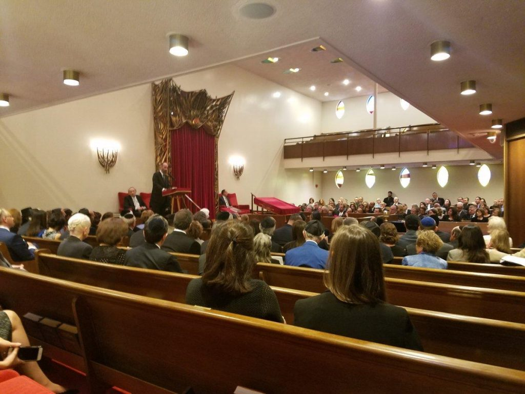 A small gathering of about 150 family and friends listening to eulogies for Elie Wiesel's life.