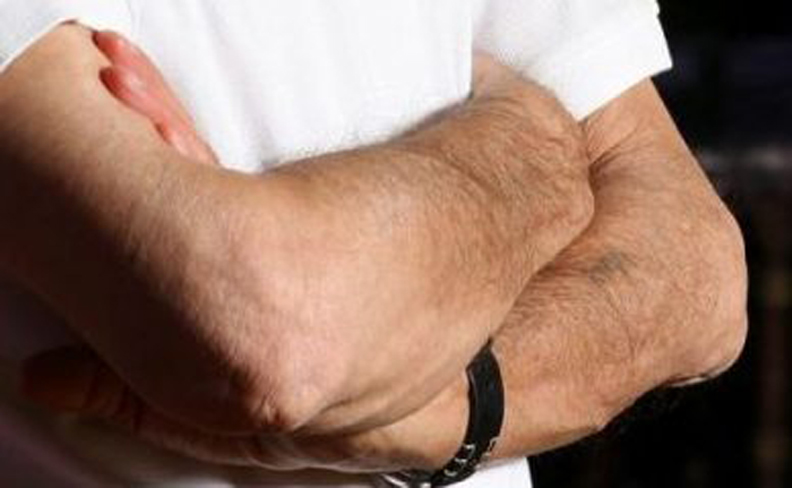 Enlarged close-up of Elie Wiesel's arms in a 2006 photograph by Eyal Poreit